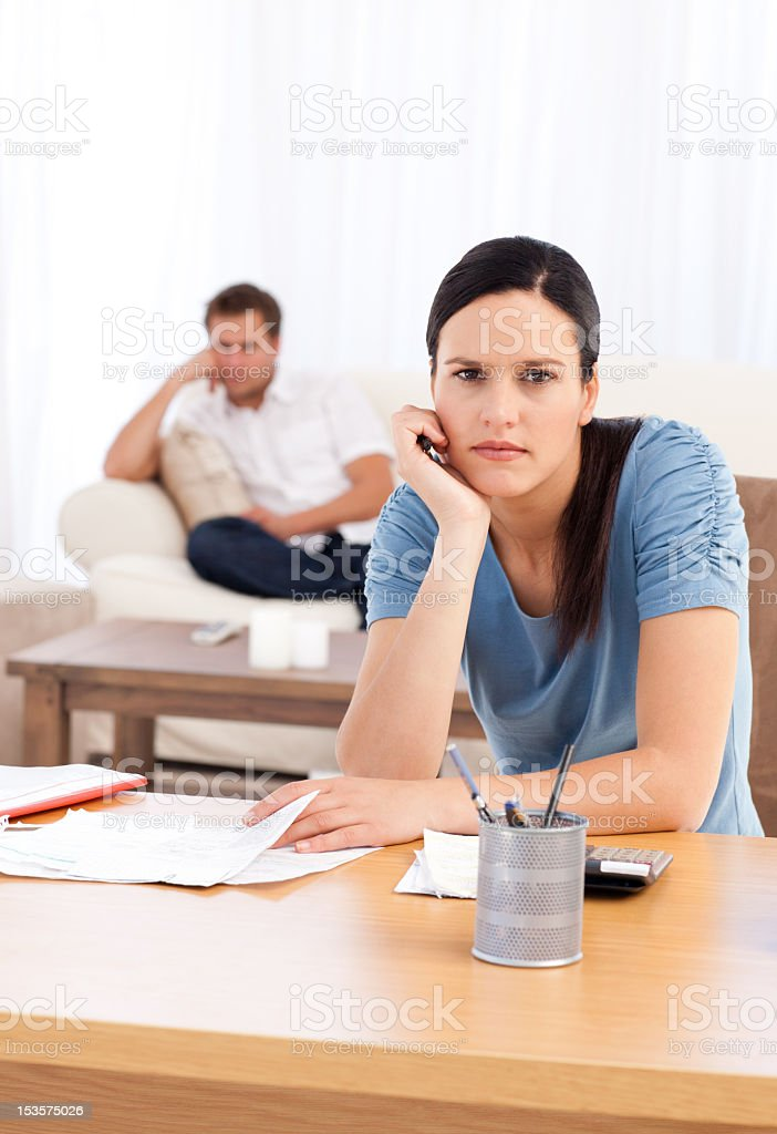 Couple sulking after doing their account together royalty-free stock photo
