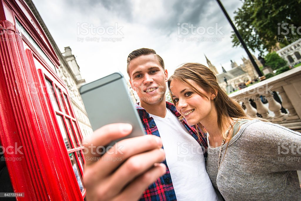 Couple take a selfie at Big ben in London stock photo