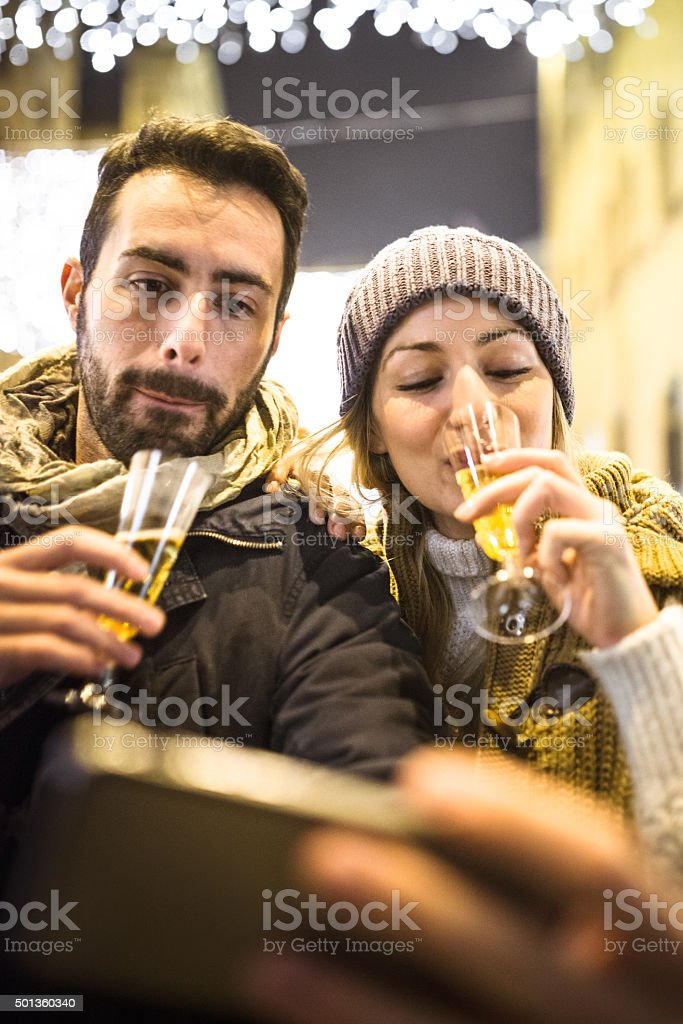 couple take a selfie for new year and drinking champagne stock photo