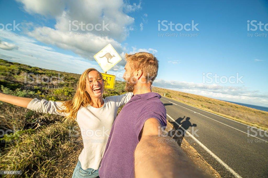 Couple take selfie with Kangaroo sign stock photo