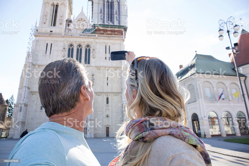 Couple take smart phone pic of cathedral stock photo