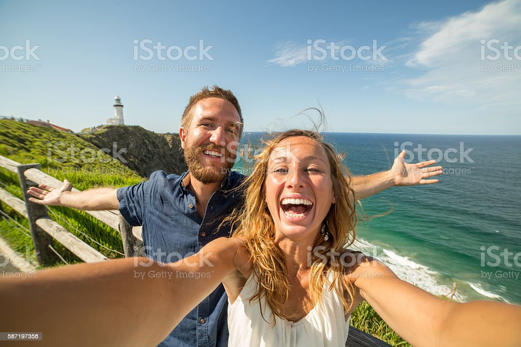 Couple takes a selfie by the sea stock photo