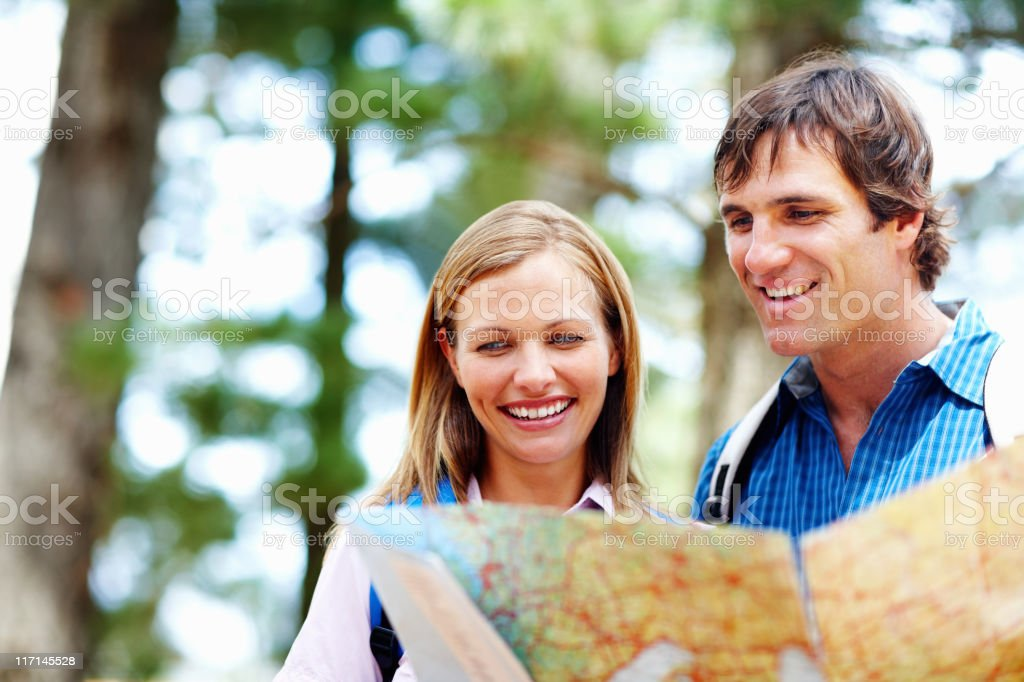 Couple taking a look at map royalty-free stock photo