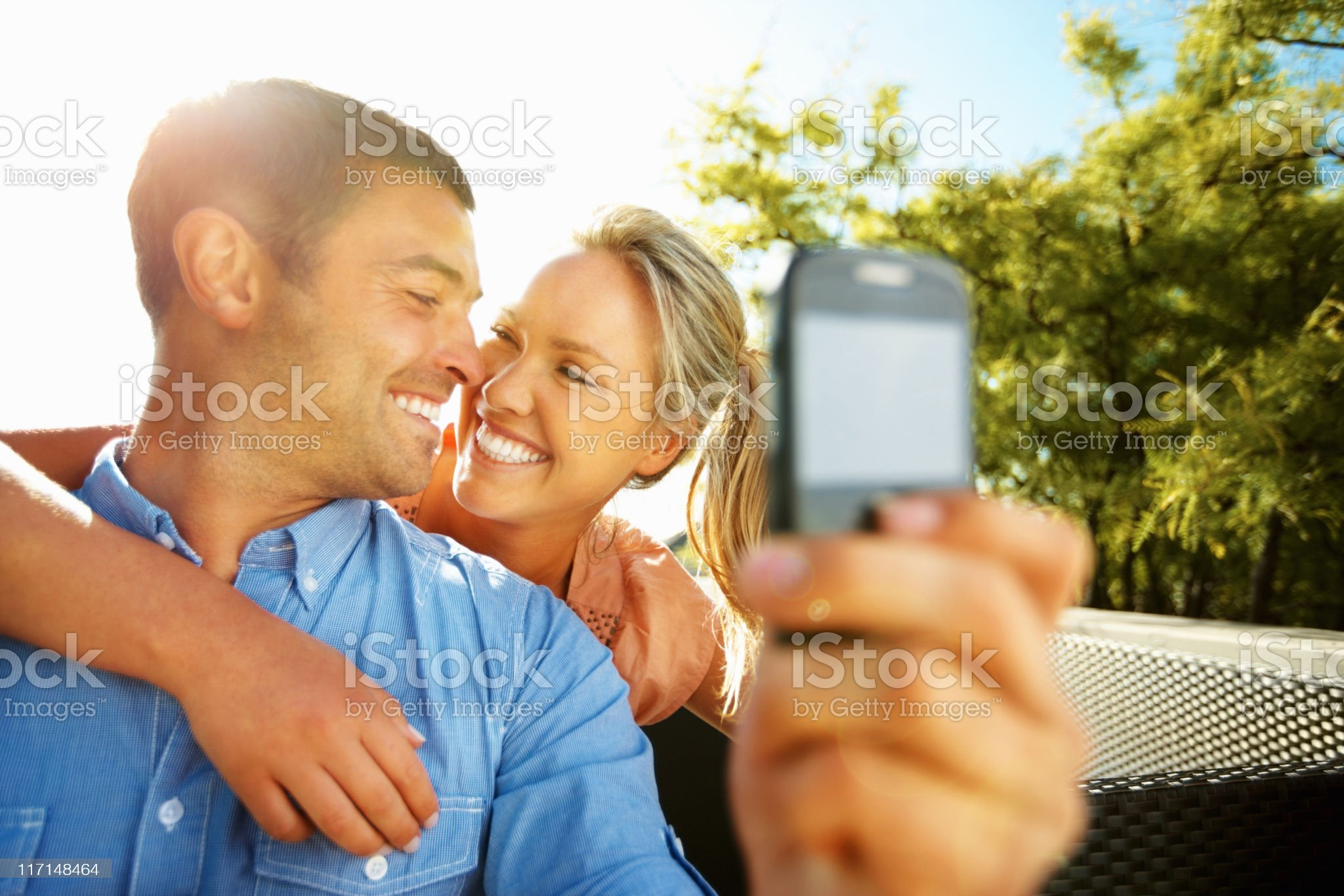 Couple taking a photo of themselves royalty-free stock photo