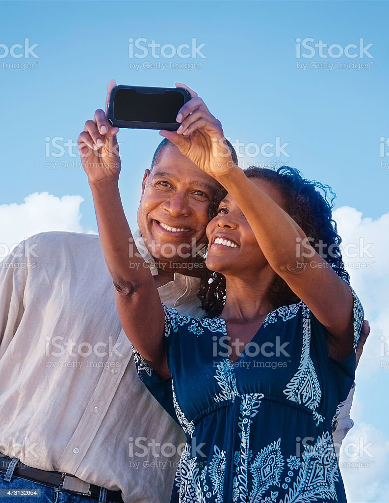 Couple taking a photo with cell phone stock photo