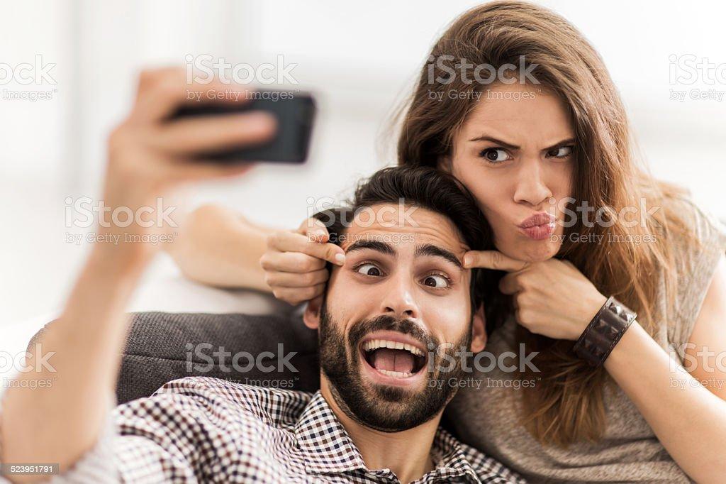 Couple taking a selfie. stock photo