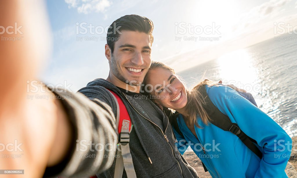 Couple taking a selfie while hiking stock photo