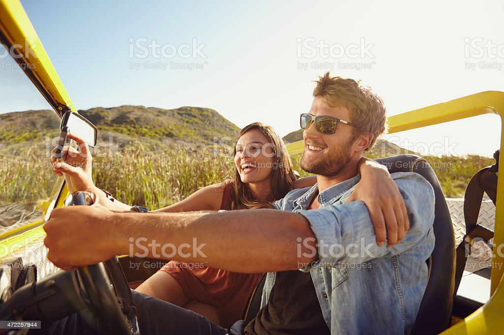 Couple taking a selfie while out on roadtrip stock photo
