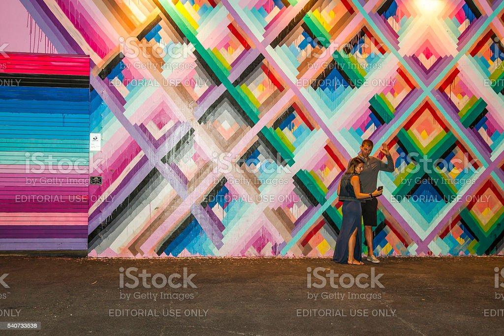 Couple taking a selfie with art murals at Wynwood Walls stock photo
