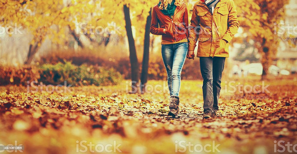 Couple taking a walk in park. stock photo