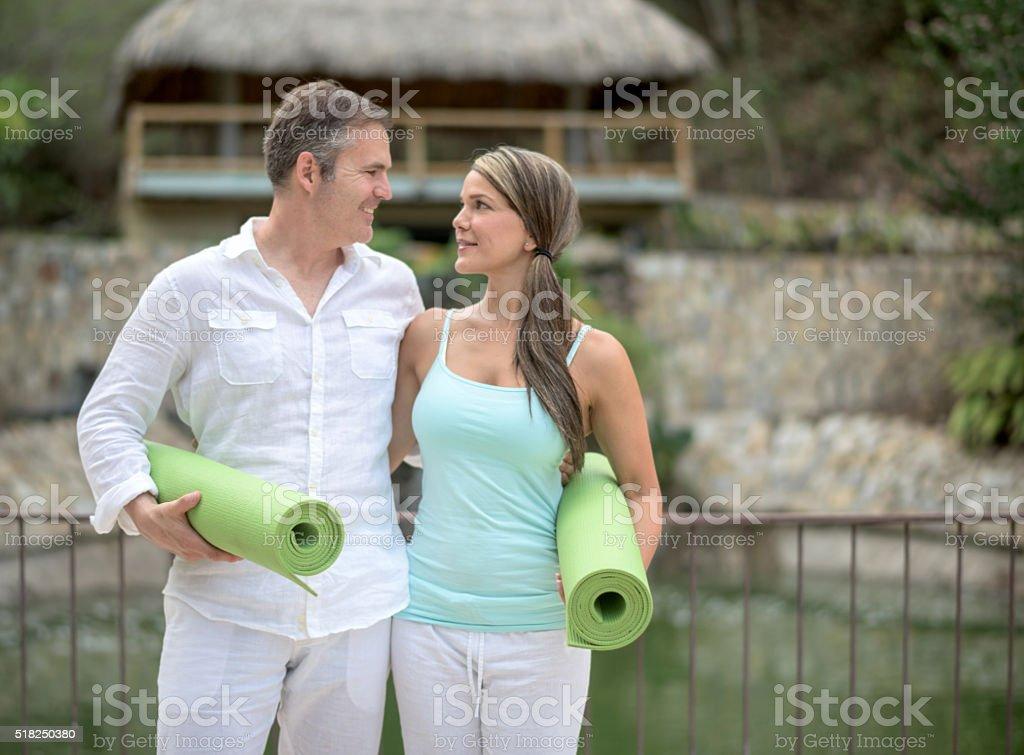 Couple taking a yoga class stock photo