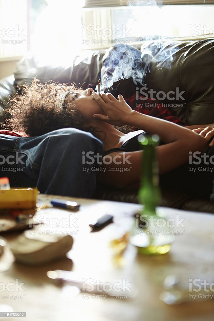 Couple Taking Drugs At Home Together stock photo