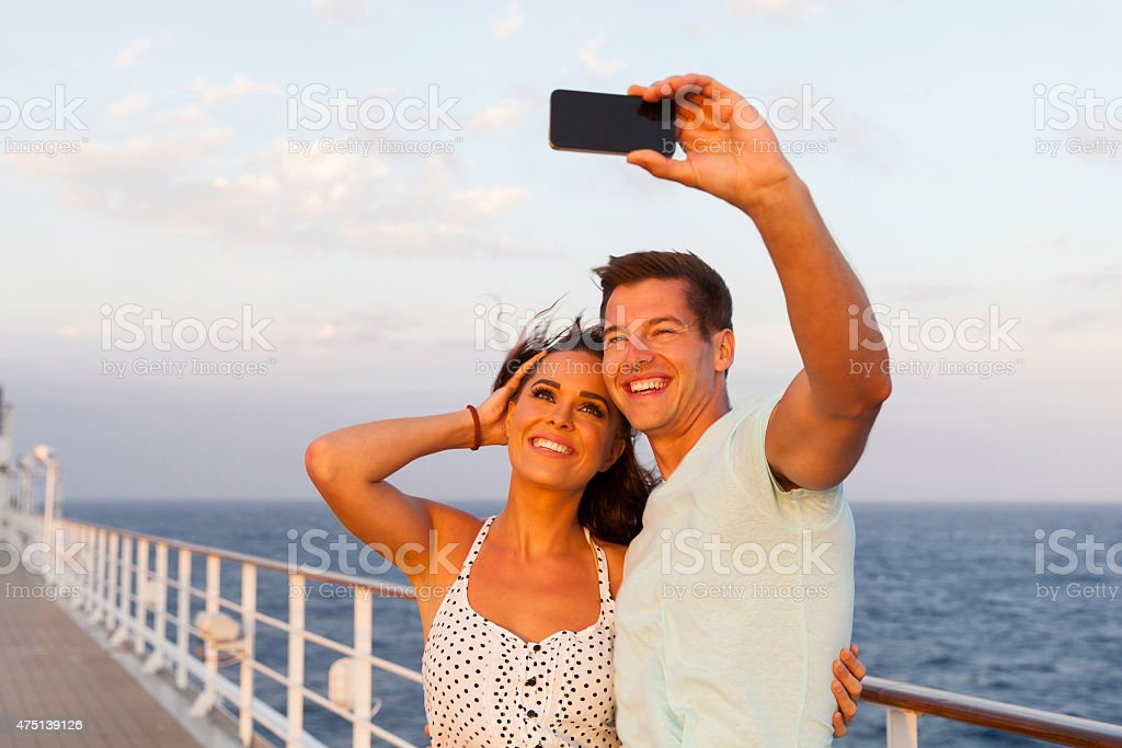 couple taking photo of themselves on cruise stock photo