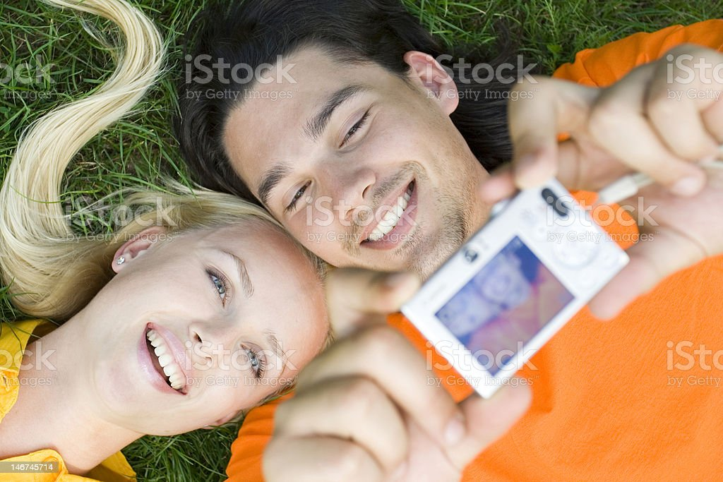 Couple taking photo of themselves royalty-free stock photo