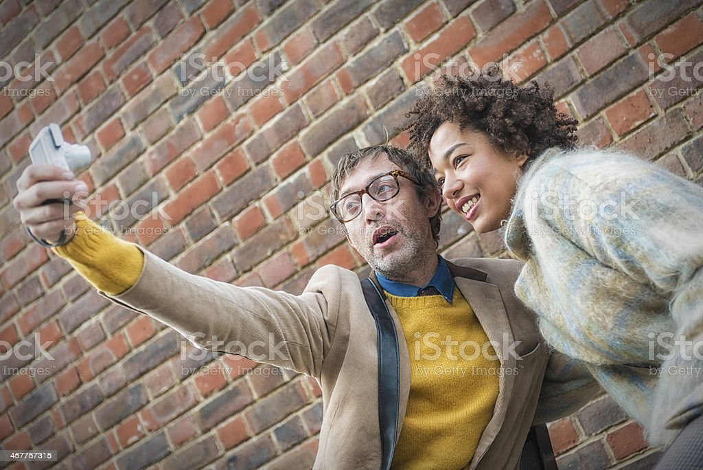 Couple taking photo themselves royalty-free stock photo