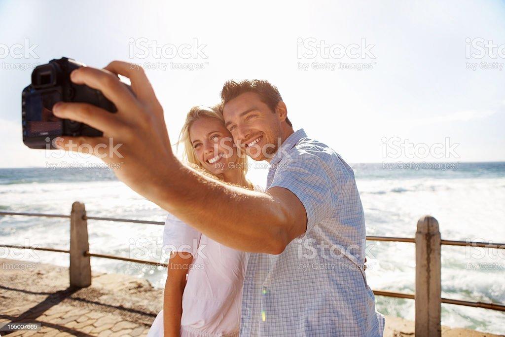 Couple taking photograph royalty-free stock photo