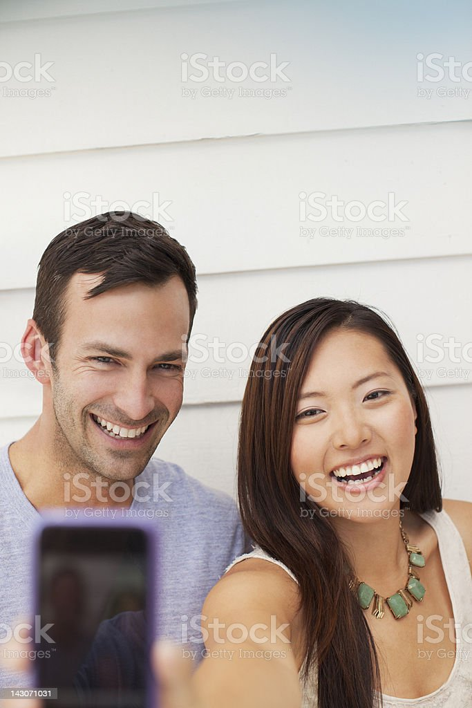 Couple taking picture of themselves royalty-free stock photo