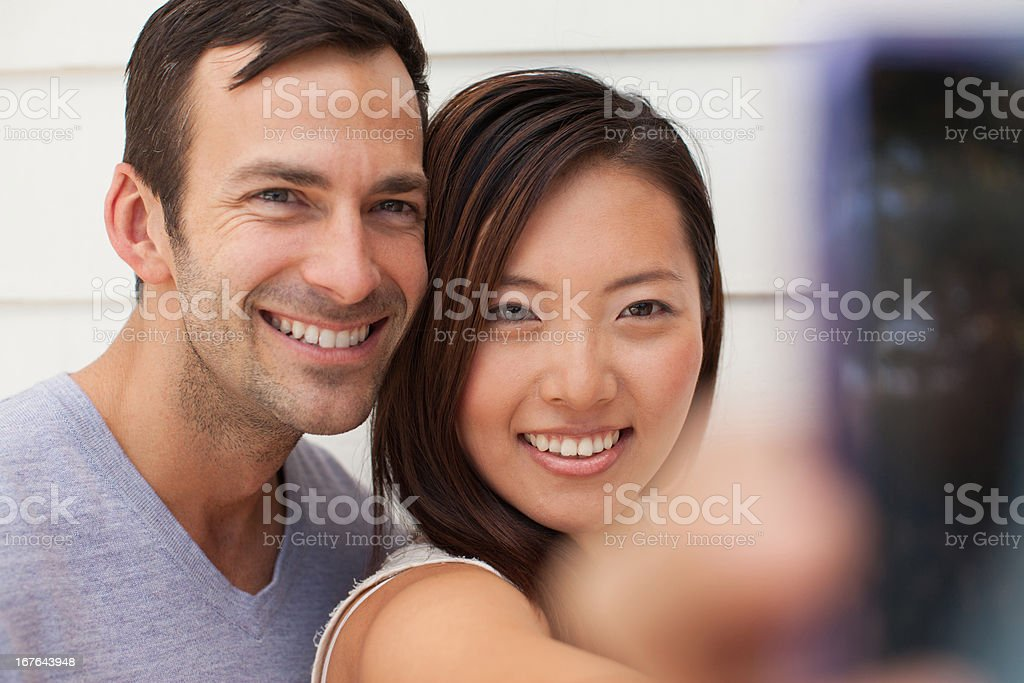 Couple taking picture of themselves stock photo