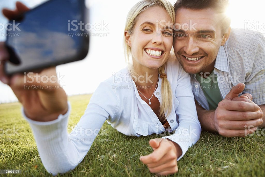 Couple taking picture on grass royalty-free stock photo
