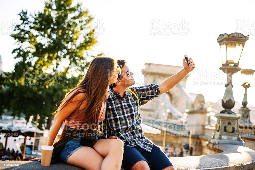 Couple taking selfie and having fun stock photo