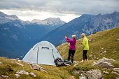 Couple taking selfie at campsite