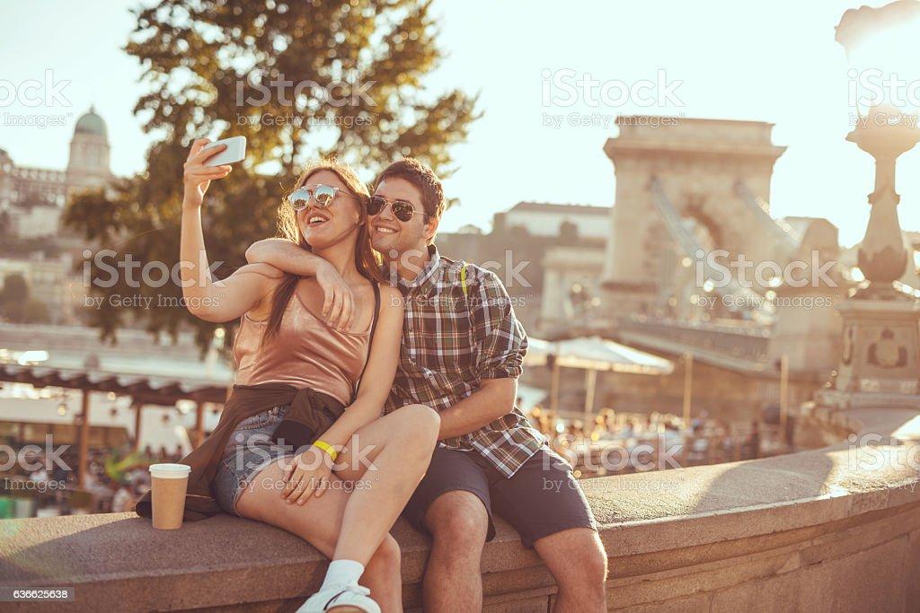 Couple taking selfie near famous landmark stock photo