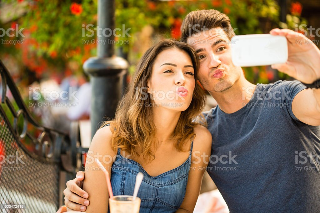 Couple taking selfie outdoors stock photo