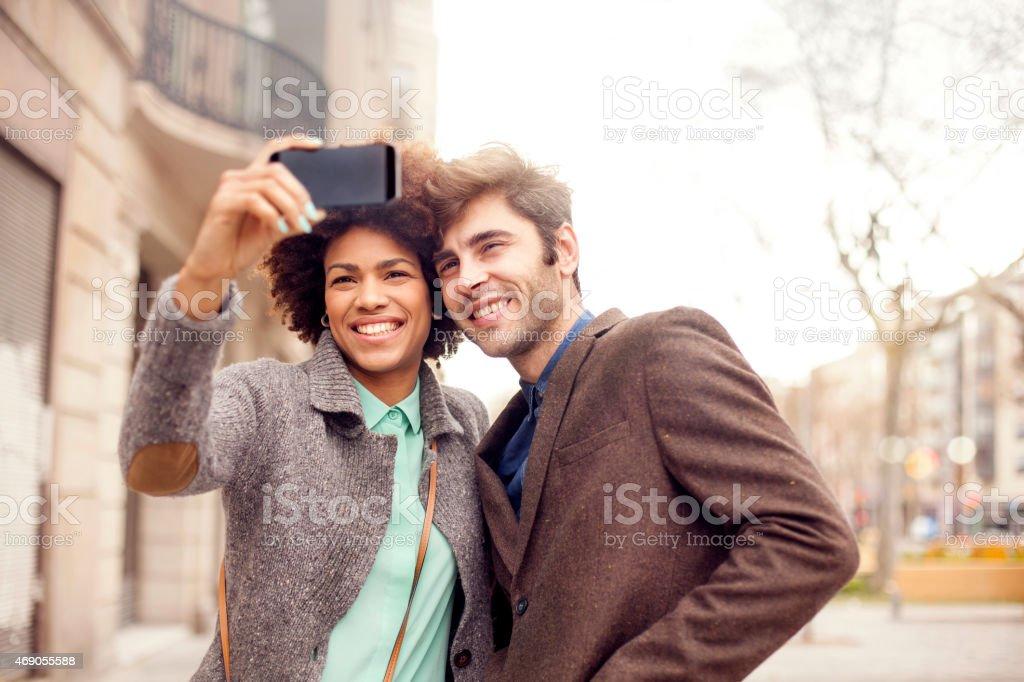 Couple taking selfie stock photo