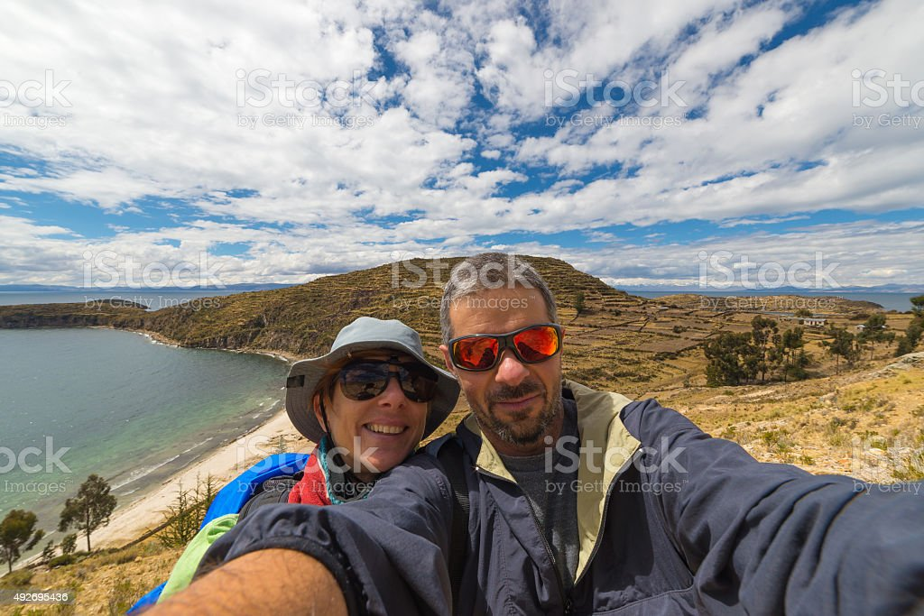 Couple taking selfie while traveling stock photo
