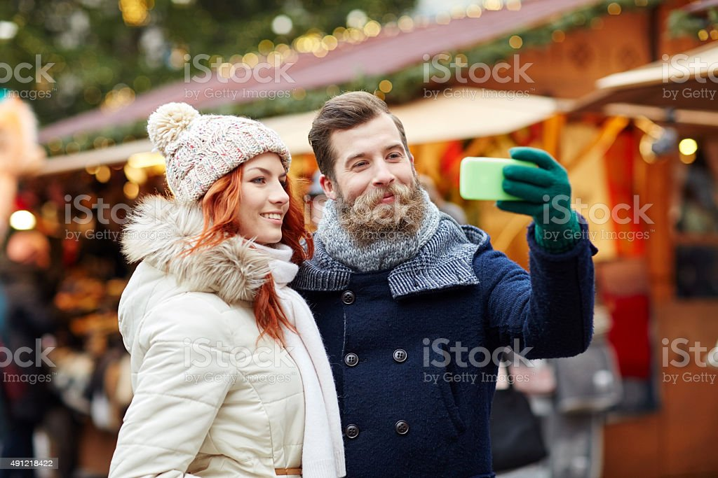 couple taking selfie with smartphone in old town stock photo