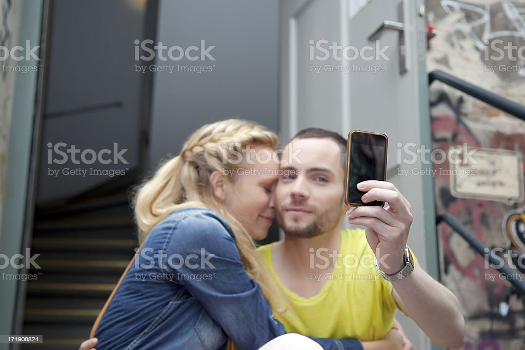 Couple taking self-portrait with a smartphone royalty-free stock photo