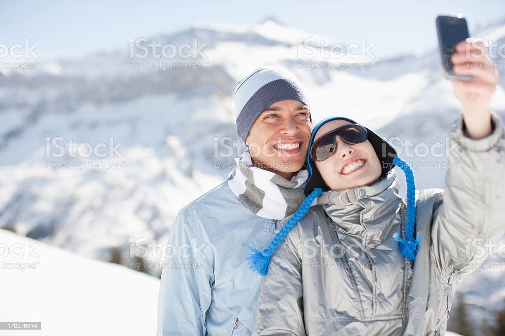 Couple taking self-portrait with cell phone royalty-free stock photo
