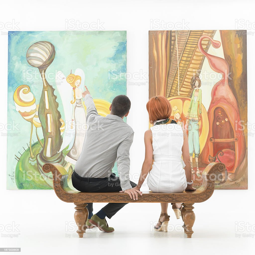 couple talking about an artwork stock photo