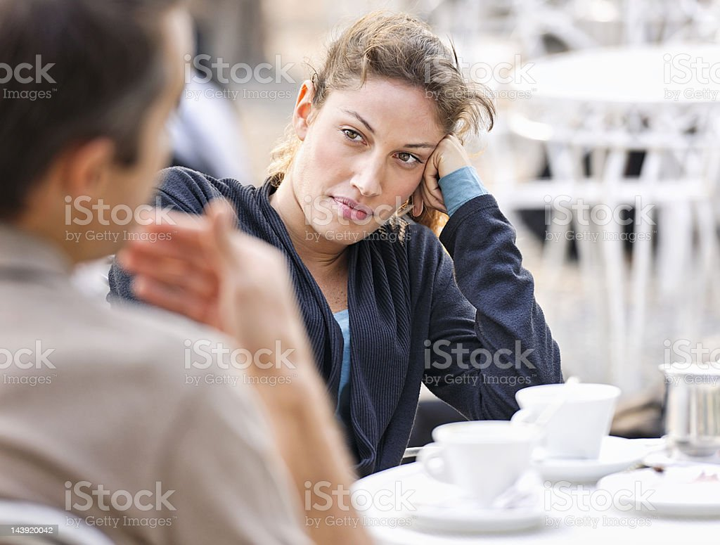 Couple Talking at a Cafe stock photo