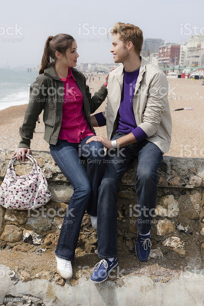 Couple talking on the beach royalty-free stock photo
