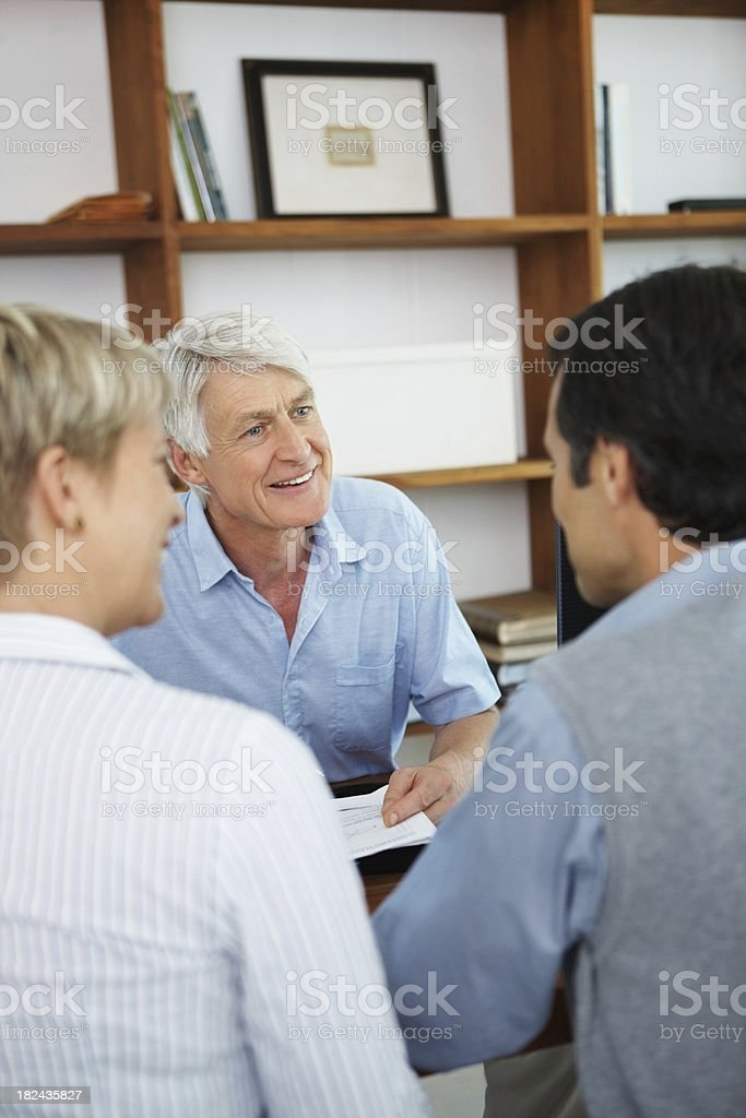 Couple talking to a senior financial planner royalty-free stock photo