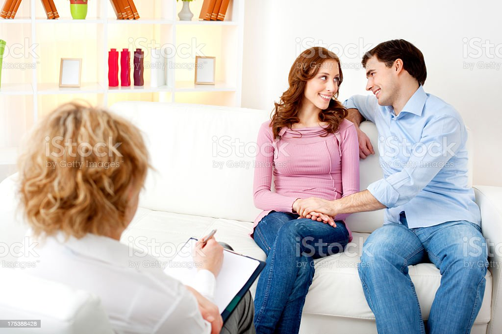 Couple Talking to Counselor. royalty-free stock photo