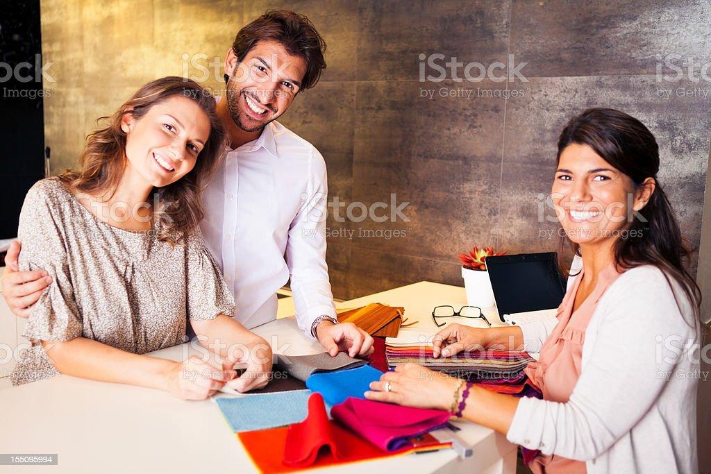couple talking to their interior designer royalty-free stock photo