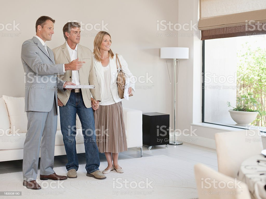 Couple talking with interior designer royalty-free stock photo