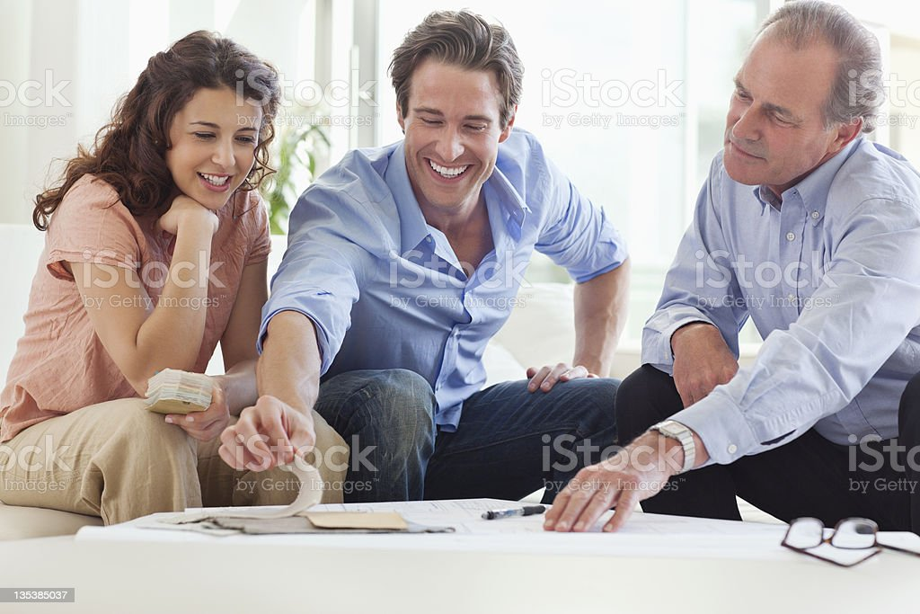Couple talking with their financial advisor stock photo