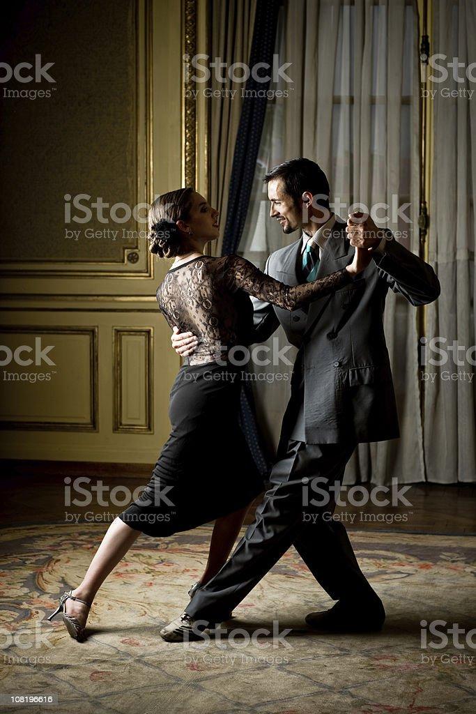 Couple Tango Dancing in Ball Room royalty-free stock photo
