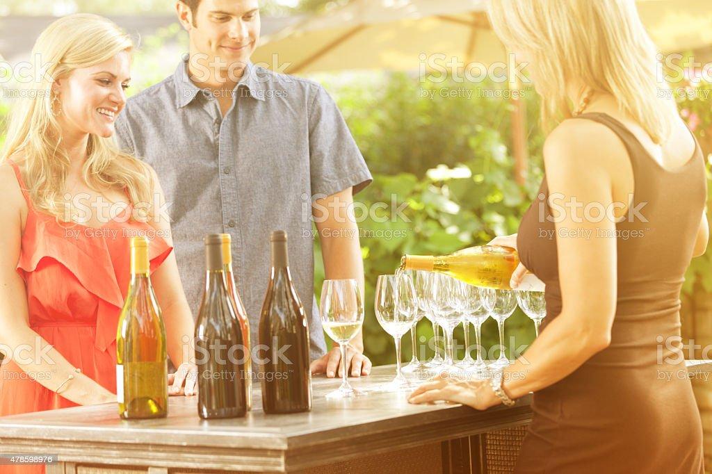 Couple Tasting Wine at Winery Vineyard Winetasting in Wine Country stock photo