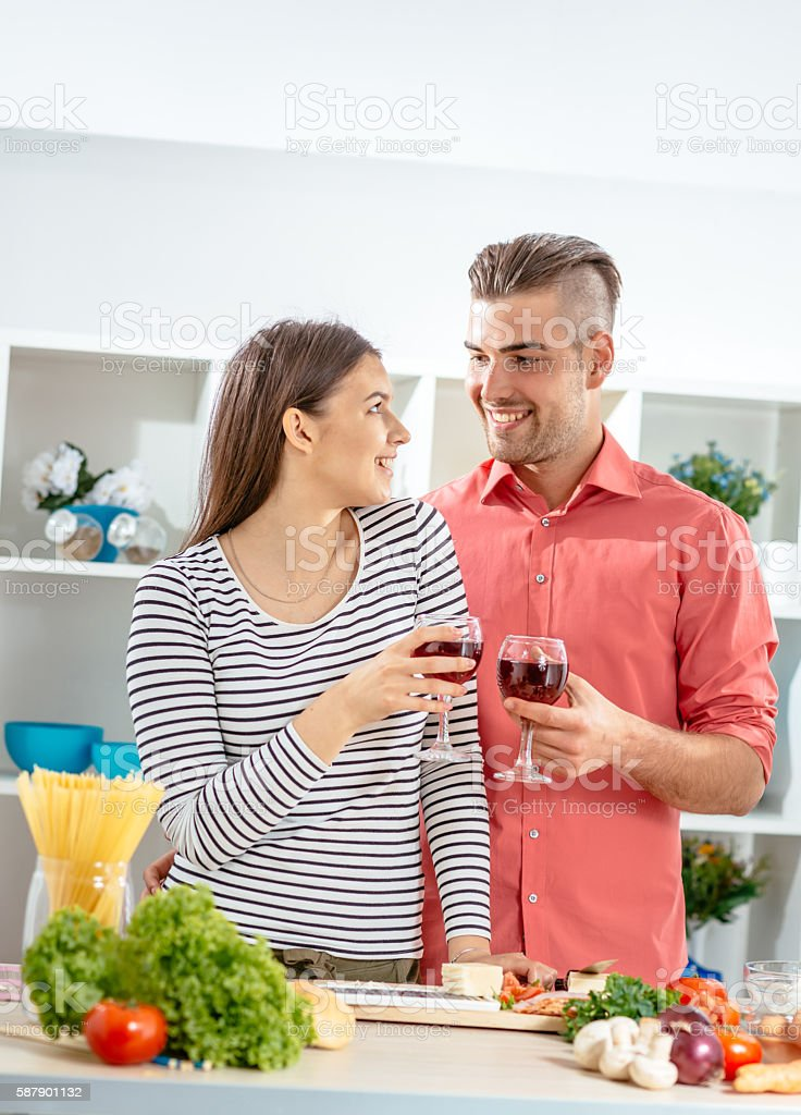 Couple toast with red wine before dinner stock photo