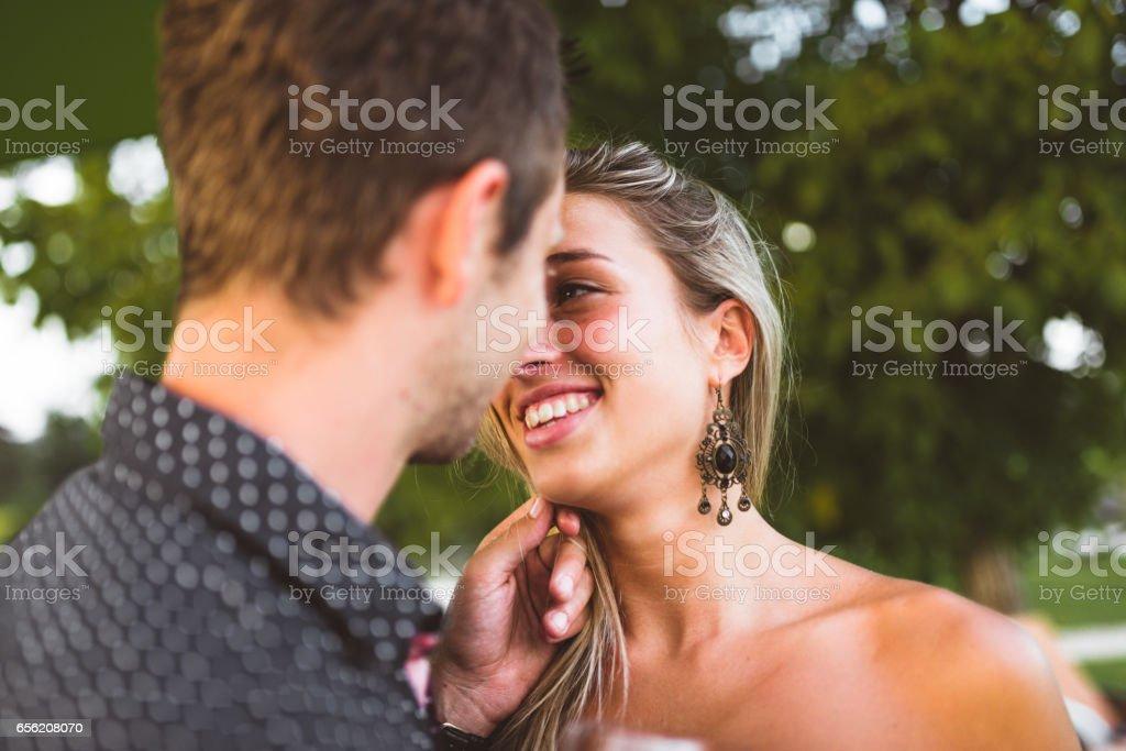 couple toasting at dusk together stock photo