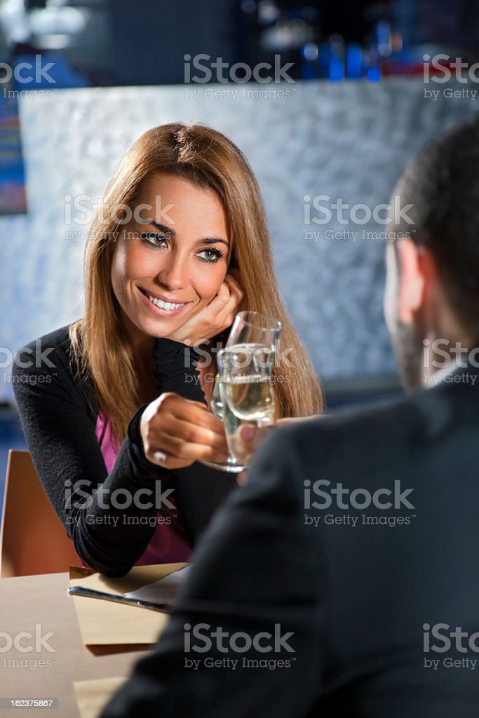 Couple toasting champagne glasses at a romantic dinner date royalty-free stock photo