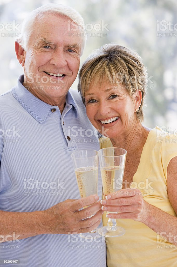 Couple toasting champagne royalty-free stock photo