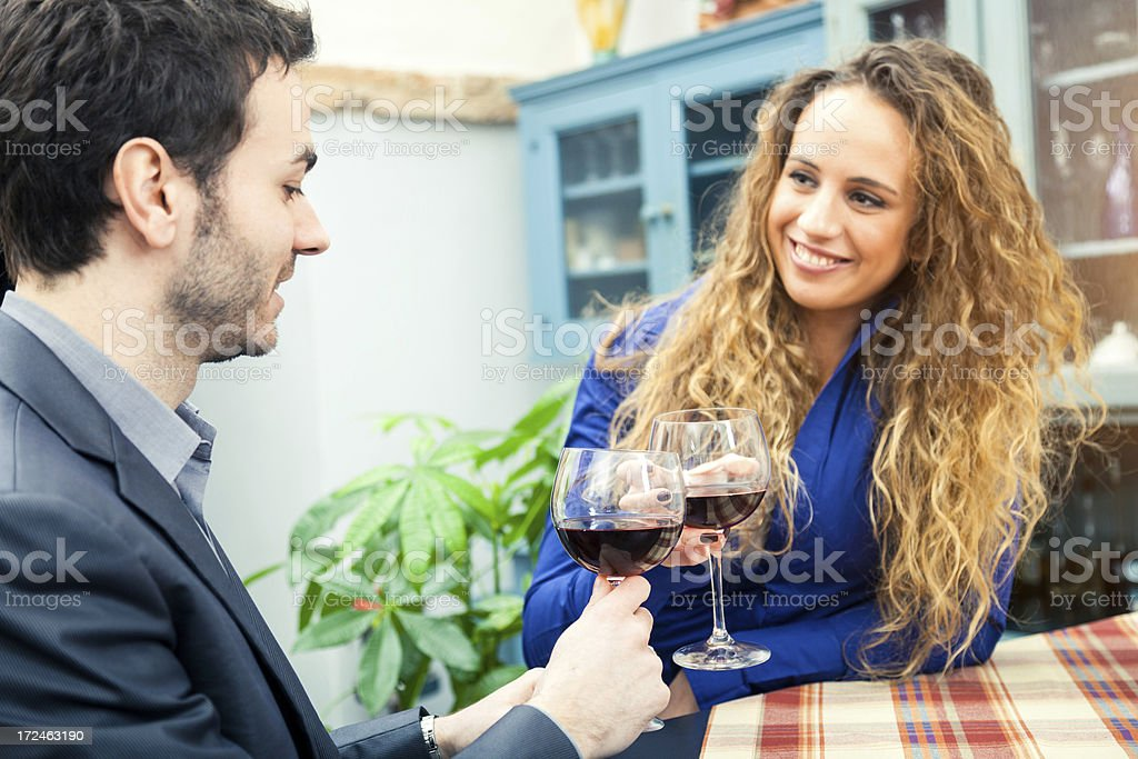 Couple toasting during italian aperitif royalty-free stock photo