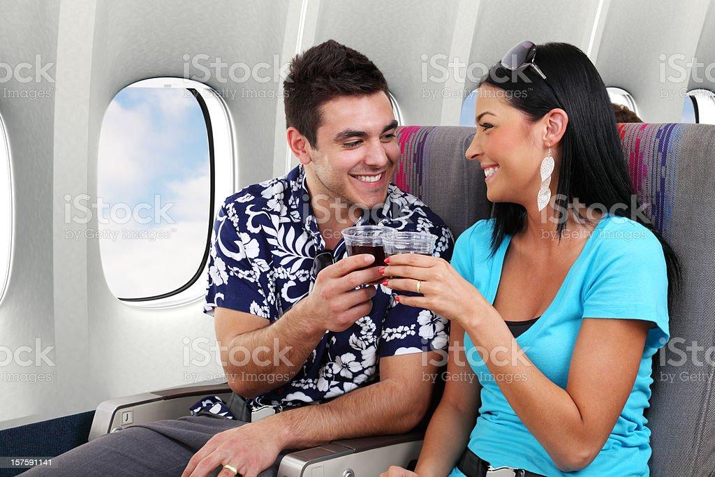 Couple Toasting On Airplane royalty-free stock photo