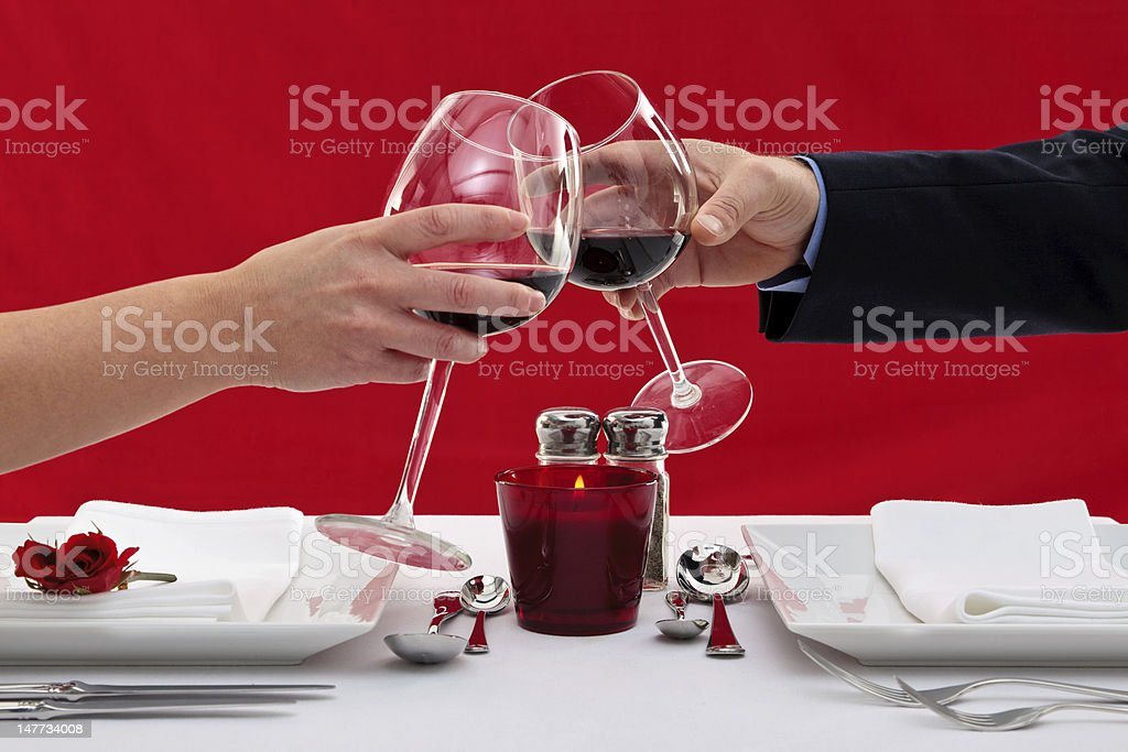 Couple toasting their glasses royalty-free stock photo