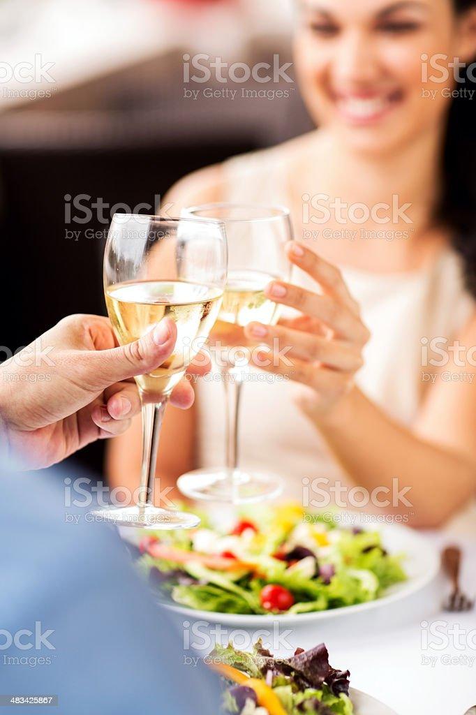 Couple Toasting Wine Glasses At Restaurant stock photo